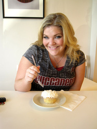 Jenni Reilly eating a cupcake